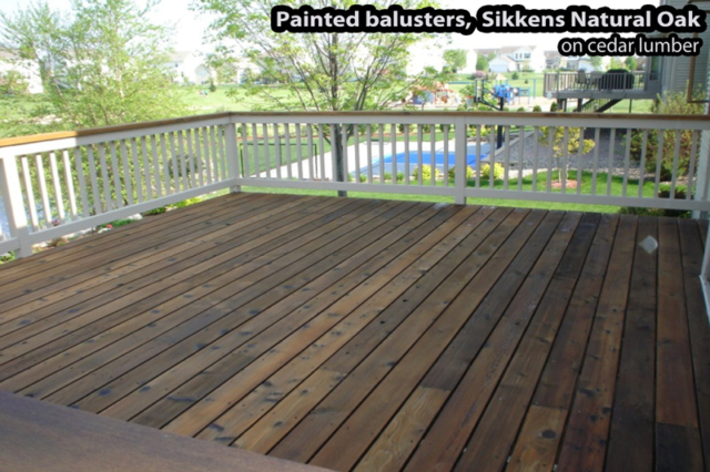 Painted railings and stained flooring of a wood deck in Edina