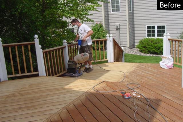 Clarke orbital sanding of a wood deck