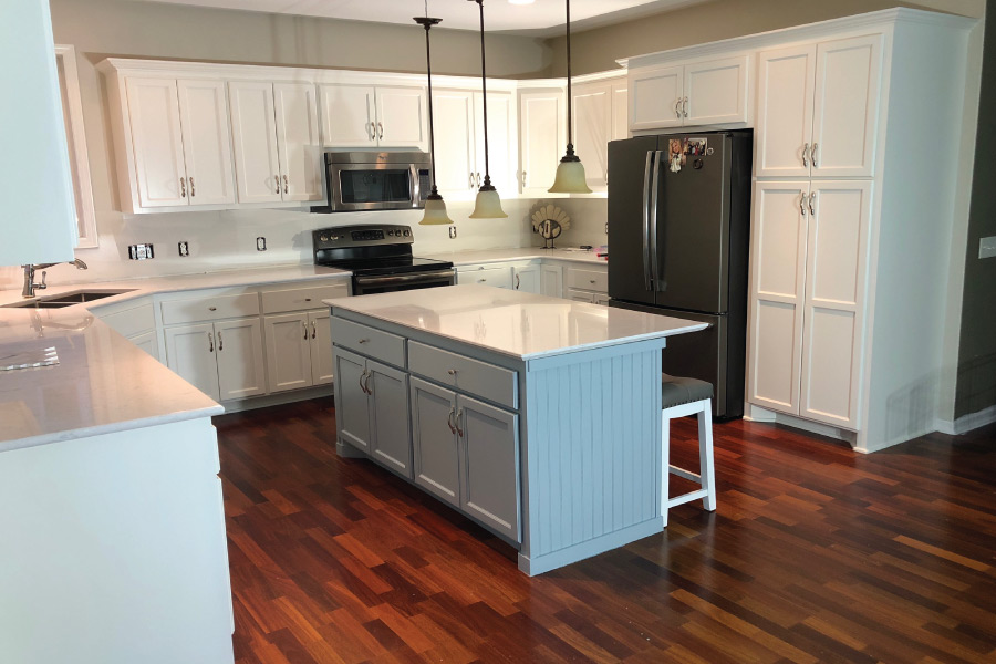 Accented painted island with white cabinet in Lakeville MN