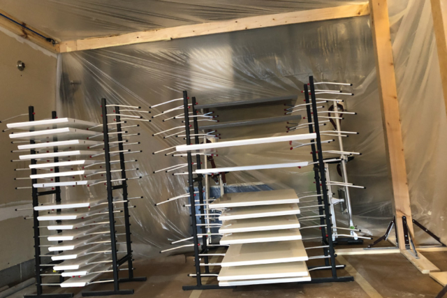 Cabinet doors drying after spraying using door rack painter