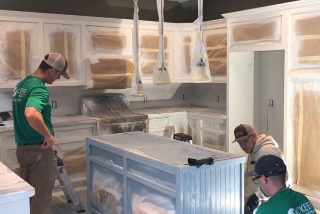Preparing kitchen cabinets before final coat of paint in Lakeville MN