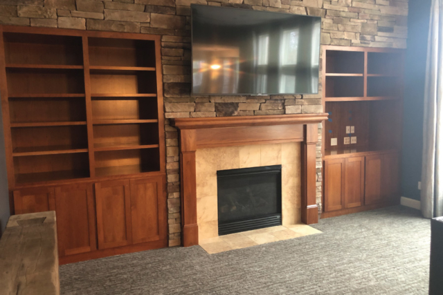 Dark stained maple entertainment built in cabinet