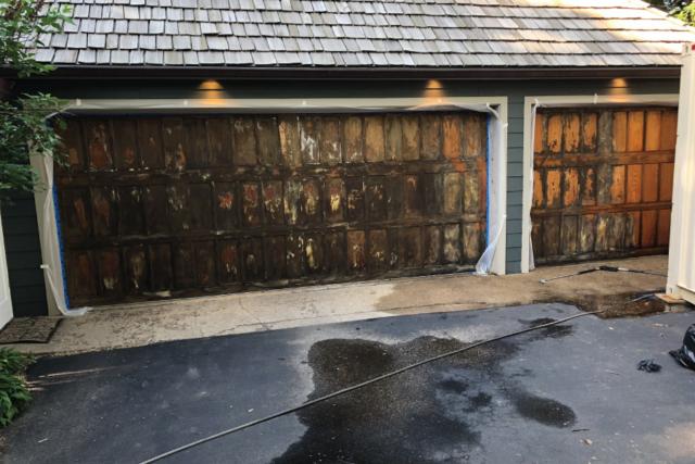 Old worn stain on a wood garage door