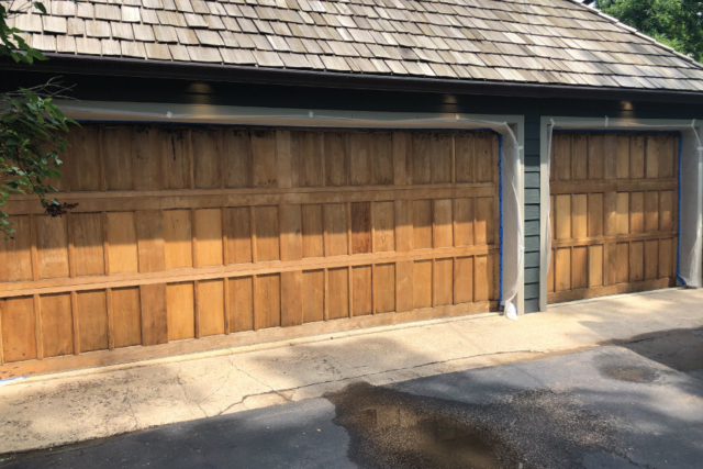 Garage door freshly stripped and sanding ready for stain application
