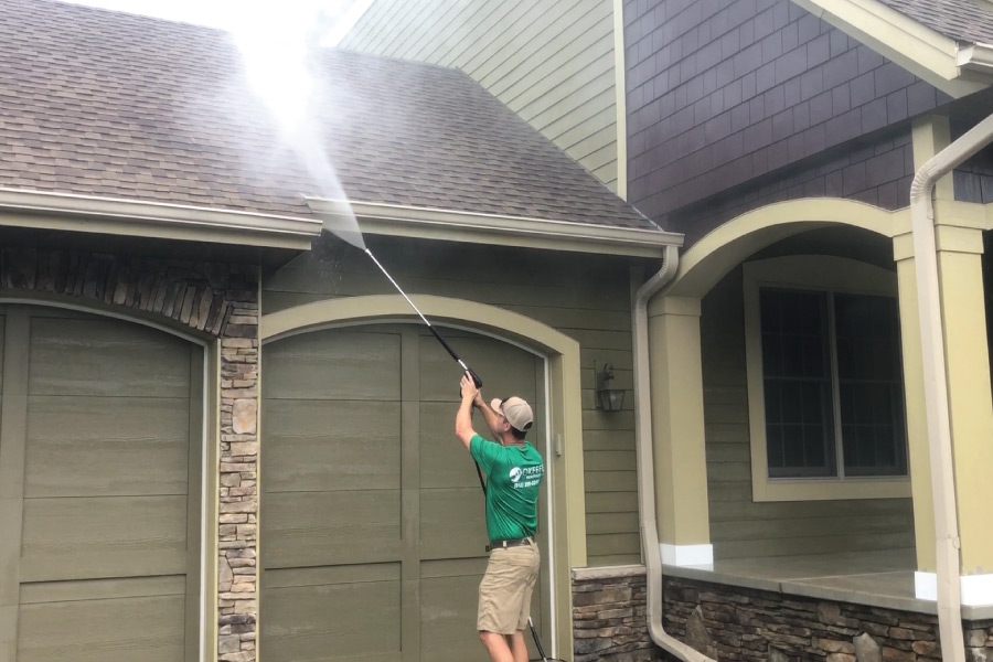 Pressure washing exterior home before painting