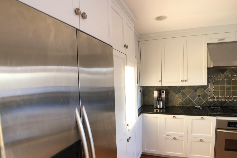 Painted cabinets with built in stainless steel fridge
