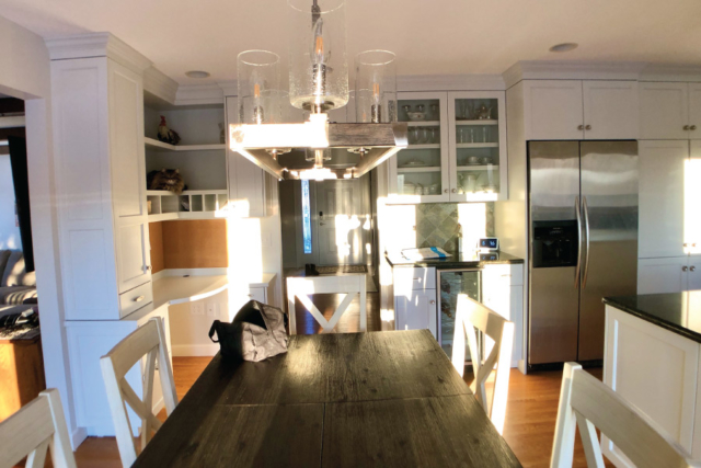 Painted cabinets with wood accented table
