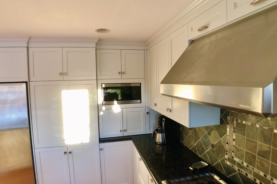 Stainless steel appliances with painted cabinets